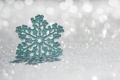 Christmas ornament on snow Stock Image