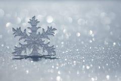 Christmas ornament on snow Stock Photos