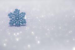 Christmas ornament on snow Royalty Free Stock Image