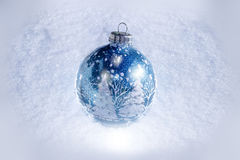 Christmas ornament on the snow. Beautiful blue, sparkly Christmas ornament on the snow Stock Photo