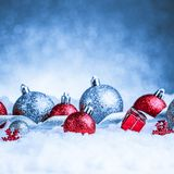 Christmas ornament in snow on glitter background Stock Images