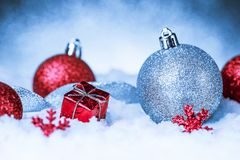 Christmas ornament in snow on glitter background Royalty Free Stock Image