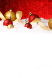 Christmas ornament in snow on glitter background Royalty Free Stock Photo