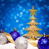Christmas ornament in snow on glitter background Royalty Free Stock Images