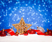 Christmas ornament in snow on glitter background. Studio shot royalty free stock photo