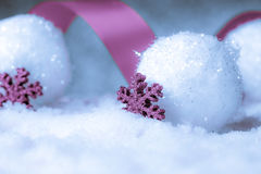 Christmas ornament in snow on glitter background royalty free stock photos