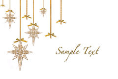 Christmas Ornament Stars Hanging from Ribbon and B. Ows Isolated on White WIth Copyspace stock image