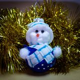 Christmas Ornament, Stuffed Snowman, Reindeer with rattle royalty free stock photography