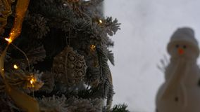 Christmas ornament on tree with bokeh lights. stock footage