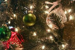 Christmas ornament on tree with lights Stock Image