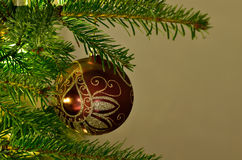 Christmas ornament on a tree. Christmas tree with red ornament Stock Photo