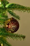 Christmas ornament on a tree. Christmas tree with red ornament Royalty Free Stock Photography