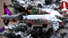 Christmas Ornament of Vehicle Transporting Christmas Tree. Vehicle appears to be a van or Winnebago type vehicle stock photography