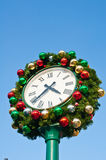 Christmas ornament on vintage clock Stock Photography