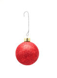 Christmas Ornament w/Hook - Red w/Glitter. A  hanging red Christmas ornament with wire hook Royalty Free Stock Photography