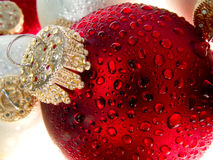Christmas ornament with water drops 4 Stock Photos