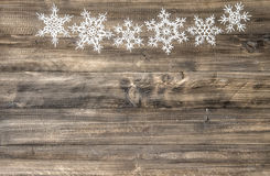 Christmas ornament white snowflakes on wooden background Stock Image