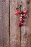 Christmas ornament on a wooden background Stock Images