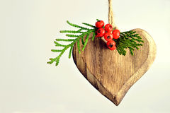 Christmas ornament. Wooden heart on light background royalty free stock image