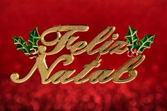 Christmas ornament wrote. `Merry Christmas` greeting in portuguese isolated on red defocused background with clipping path Royalty Free Stock Photo