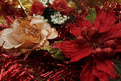 Christmas ornamental red and golden flowers Stock Image