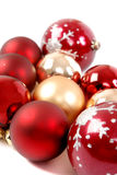 Christmas Ornaments. Red and Gold Christmas ornaments on white Royalty Free Stock Photo