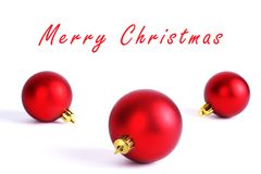 Christmas ornaments. Three round red christmas ornaments isolated on white Stock Images