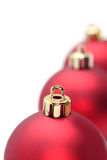 Christmas ornaments. Three red xmas balls lined up in a row stock image