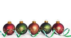Christmas ornaments. Holiday christmas ornaments and ribbon Royalty Free Stock Image