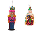 Christmas Ornaments. Brightly colored glass Christmas ornaments of a soldier set against a white background Royalty Free Stock Photography