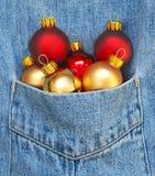 Christmas ornaments. A pocketful of Christmas decorations Stock Photos
