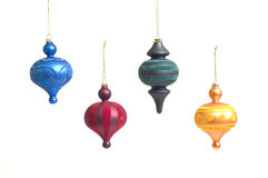 Christmas Ornaments. Four different colored Christmas ornaments Royalty Free Stock Images
