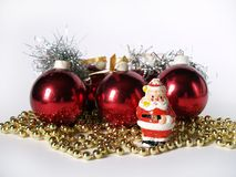 Christmas ornaments. Christmas balls and small Santa Claus Royalty Free Stock Photos