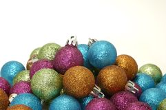Christmas Ornaments. Photo of Various Color Christmas Ornaments on a White Background Royalty Free Stock Photography