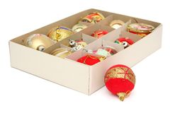 Christmas ornaments. In the box and a lonely one Royalty Free Stock Photography