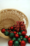 Christmas ornaments. A basket of Christmas ornaments turned over royalty free stock photo