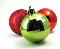 Christmas ornaments. Three Christmas ornaments, two red balls and one golden Stock Images