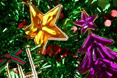 Christmas Ornaments. Colorful christmas ornaments on green tinsel Royalty Free Stock Photos