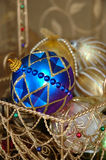 Christmas Ornaments. In a gold wire basket stock image