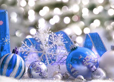Christmas ornaments. Blue colored ornaments and christmas lights Royalty Free Stock Images