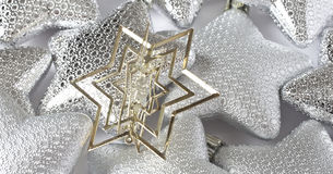 Christmas ornaments. Christmas stars ornaments, silver and gold Royalty Free Stock Photography