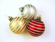 Christmas ornaments. 3 christmas ornaments (glass balls) on white background Royalty Free Stock Photo