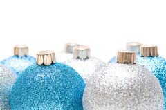 Christmas ornaments. An isolated shot of blue and silver christmas ornaments Royalty Free Stock Photos