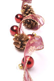Christmas ornaments. On white background: ribbon, cones and red balls royalty free stock photo