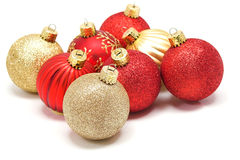 Christmas Ornaments. Red and gold Christmas ornaments on white background Stock Photo
