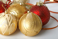 Christmas Ornaments. Gold and red Christmas ornaments on white background Stock Photos
