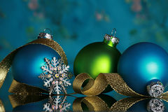 Christmas ornaments. And snowflake on reflective surface, focus on snowflake Royalty Free Stock Photography