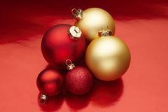 Christmas ornaments. Red and gold Christmas ornaments on a colorful background Stock Photography