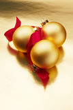 Christmas ornaments. Gold Christmas ornaments on a colorful background Stock Photography