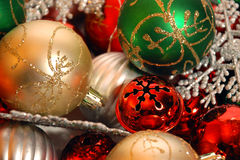 Christmas ornaments. Multicolored christmas ornaments clustered on white background Royalty Free Stock Images